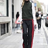 Hack: A turtleneck sweater — even a sleeveless one — still counts as a layer. Add one to your look and finish it with a choker to emphasize the silhouette.