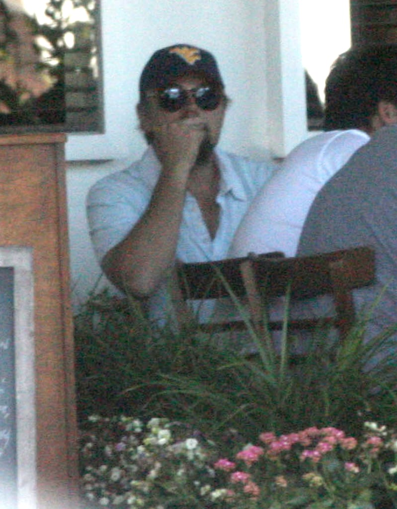"""Leonardo DiCaprio linked up with his guy friends for lunch at Fred Segal's Mauro's Cafe in LA yesterday. He's home again in California after a Summer getaway with his girlfriend. Leo was shirtless along with a bikini-clad Erin Heatherton for a few days of fun in the Hawaiian sun. The vacation came during a break for Leo from work on Django Unchained with director Quentin Tarantino. Leo didn't join Quentin and his costars Jamie Foxx, Christoph Waltz, and Kerry Washington to chat up Django Unchained at Comic-Con last weekend. Christoph, nonetheless, had only nice things to say about Leo. He said, """"I took a liking to [Leo] right away. He's so bright and alert and full of energy and inspiration and imagination."""""""