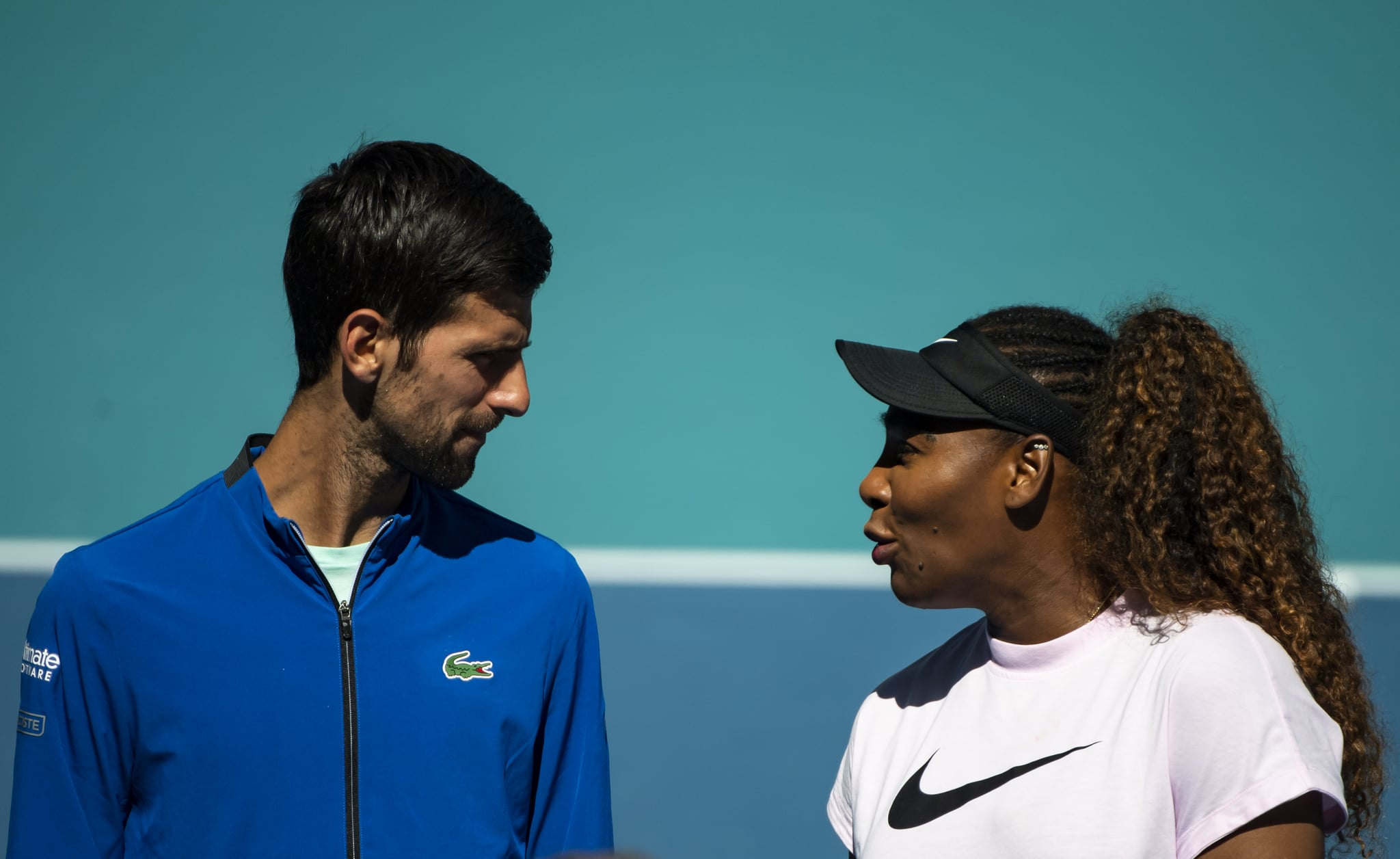 MIAMI GARDENS, FLORIDA - MARCH 20: (L-R) Novak Djokovic of Serbia and Serena Williams of the United States talk during the ribbon cutting ceremony on the new Stadium Court at the Hard Rock Stadium, before the first match of the Miami Open on March 20, 2019 in Miami Gardens, Florida. (Photo by TPN/Getty Images)