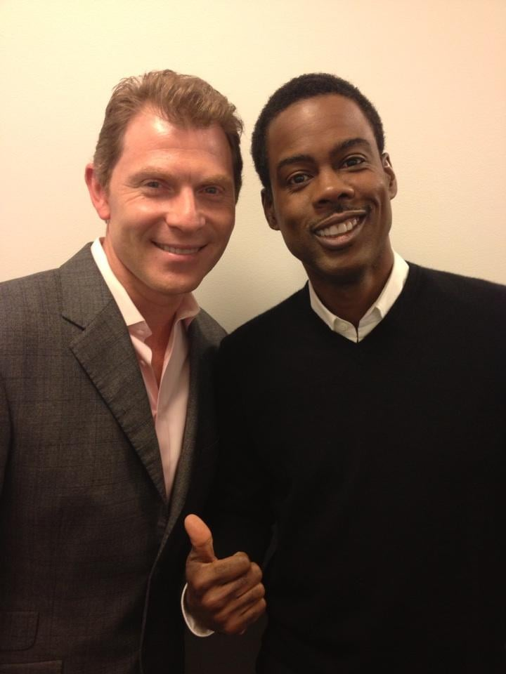 Bobby Flay and Chris Rock posed together at an event
