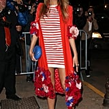 The star flaunted her stems in a stripped mini and embellished overcoat at the Vanity Fair dinner for her second night at Cannes.