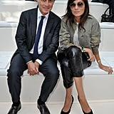 Emmanuelle Alt styled up her black leather pants with a pair of pointy-toe pumps and a laid-back khaki military jacket.