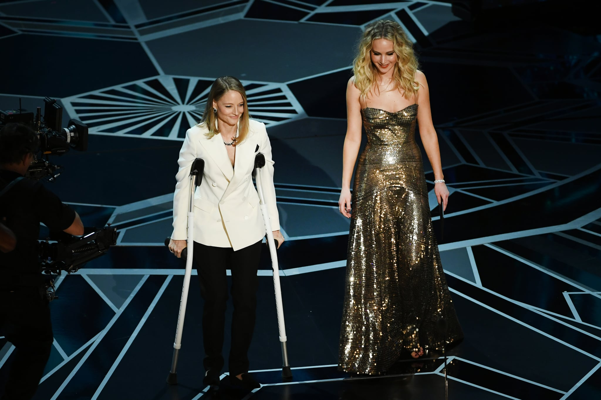 HOLLYWOOD, CA - MARCH 04:  Actors Jodie Foster (L) and Jennifer Lawrence speak onstage during the 90th Annual Academy Awards at the Dolby Theatre at Hollywood & Highland Center on March 4, 2018 in Hollywood, California.  (Photo by Kevin Winter/Getty Images)