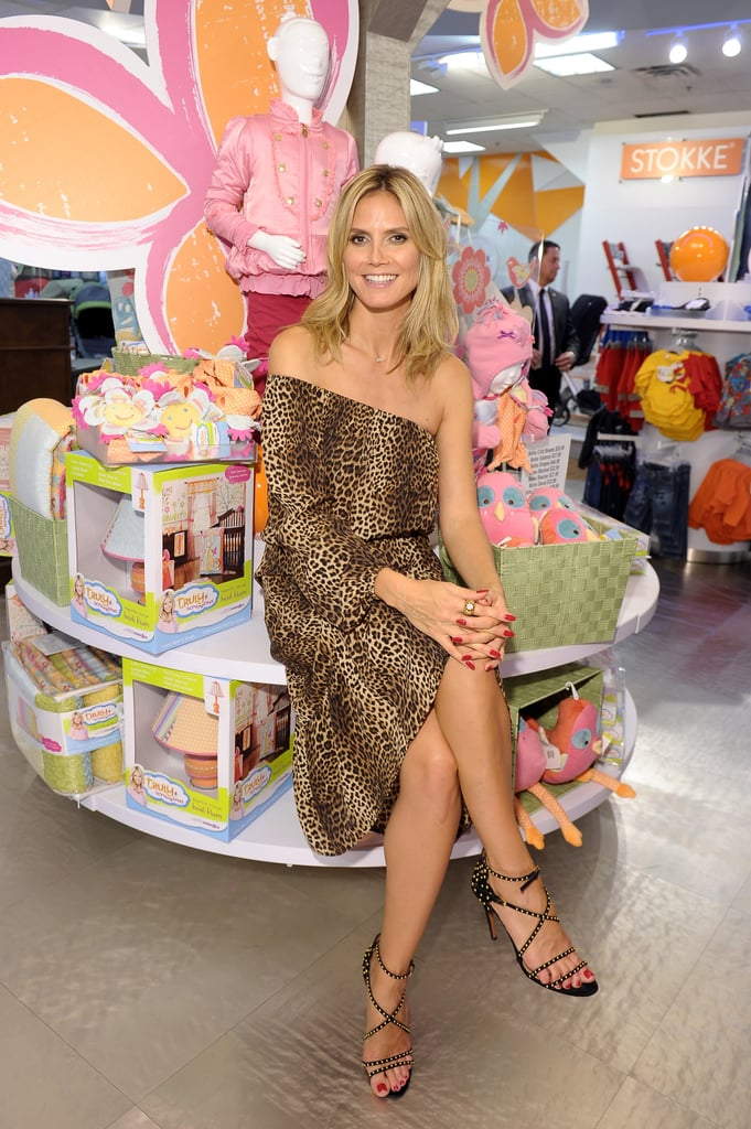 "Heidi Klum paired a Michael Kors dress with Alaia heels to launch her new Babies""R""Us collection, Truly Scrumptious, in NYC yesterday. Her collaboration contains apparel, bedding, furniture, and more for kids, and arrives in stores and online Sept. 15. We caught a few minutes with the supermodel mogul to hear about her inspiration, her four kids, and more. Stay tuned for video of our chat later today on PopSugar Rush. Here are highlights from our chat with Heidi:  On her schedule: ""I don't really travel that much anymore — I really don't! I come to New York for three months in the summertime when the kids are off from school and we pretty much move here for the Summer. Otherwise, I'm pretty much based in LA because they go to school."" Her top tip for great skin: ""I think what is really important is to drink a lot of water always — to be hydrated. I think that is number one for your skin. Finding good moisturizer. Eating right. You are what you eat — there's a lot to that, for sure."" On her advice to young models: ""There are so many beautiful girls in the world. At the end of the day, it really is important that they fight more to get to the top. People don't just come and take you by the hand and say, 'Come with me! And we can find all these great jobs together.' You really have to work on it, too. You have to do a lot of castings. You have to take care of yourself. You have to be healthy, so your hair, your skin, everything looks good. Be nice to people so that they hopefully will work with you again. """