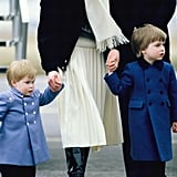 Aww! Harry and William sported matching blue coats as they held hands with their mother while arriving in Scotland back in March 1986.