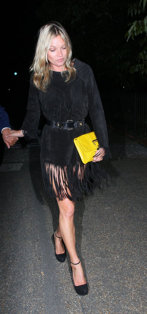 Kate Moss wore a black fringed dress in London.