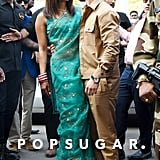 For her first outing as a married couple, Priyanka wore a green sari with cat-eye sunglasses. Nick styled his khaki set with Westward Leaning sunglasses,