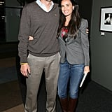 Coordinated casuals with hubby Ashton Kutcher in December '08.