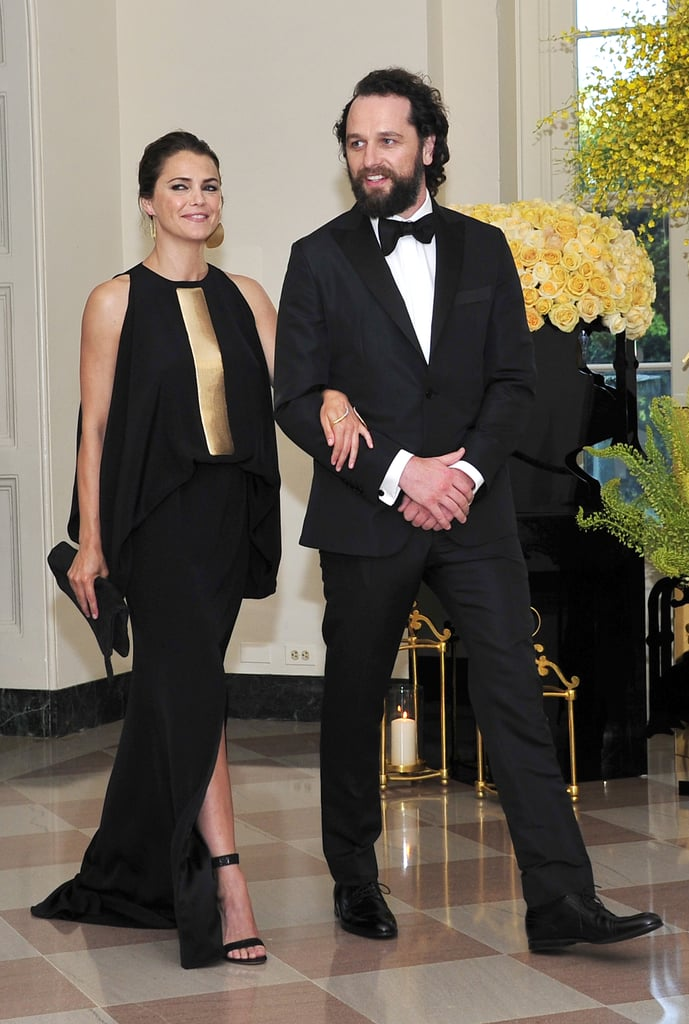 Keri Russell made a gorgeous appearance at a state dinner hosted by Barack and Michelle Obama at the White House on Tuesday. The actress, who recently gave birth to her third child, was accompanied by her boyfriend, Matthew Rhys, and looked stunning in a black floor-length gown. The outing marks Keri's second public appearance since she welcomed her first child with her The Americans costar. In June, she drew stares when she returned to the red carpet at the Tony Awards in NYC. Keri is also mom to daughter Willa, 4, and son River, 9, with ex-husband Shane Deary.