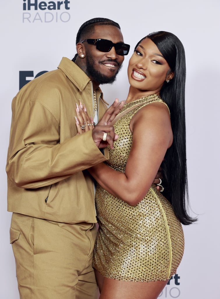 """Nothing says red carpet couple debut like coordinated outfits, am I right? On May 27, Megan Thee Stallion and her boyfriend, Pardison """"Pardi"""" Fontaine, hit the red carpet for the 2021 iHeartRadio Music Awards, and they sure looked good. They wore matching gold and beige outfits and couldn't keep their hands off each other while posing for pictures. The couple had a lot to celebrate, as Megan and Beyoncé took home the award for best collaboration for """"Savage Remix.""""  Ever since Megan and Pardi confirmed their relationship in February, they've gotten more and more comfortable flaunting their love for one another on social media, and now on the red carpet. We simply love to see it. Check out photos of Megan and Pardi at the iHeartRadio Music Awards, because that is some real hot girl sh*t.       Related:                                                                                                           The iHeartRadio Music Awards Red Carpet Is Here to Wow You Before the Long Weekend"""