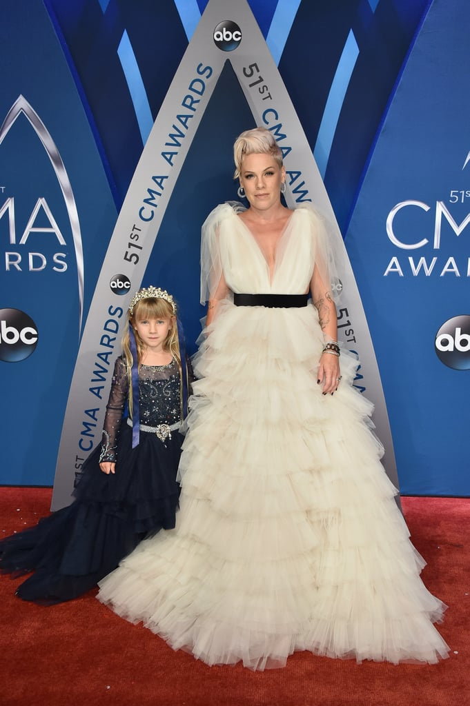 Pink and her 6-year-old daughter, Willow, wore whimsical fairy tale dresses while walking the CMA Awards red carpet on Wednesday night, and they looked like two real-life princesses. The 38-year-old doting mom opted for an off-white ruffled dress while Willow donned a studded black dress and a crown. Pink is scheduled to perform at the 51st annual musical event, and we love that she brought her daughter along to enjoy the festivities. Read on to see more adorable photos of Pink and Willow on the red carpet.