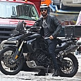 Justin Theroux rode left on a motorcycle.