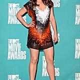 Mila Kunis rocked a colorful mini dress on the red carpet.