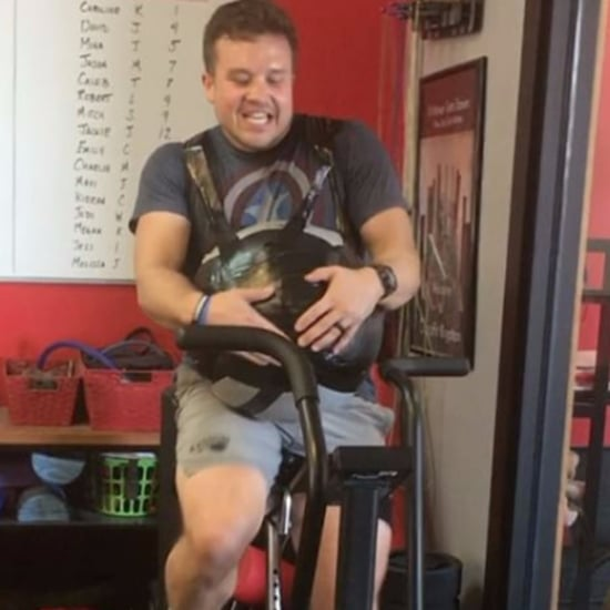 Dad Wears Medicine Ball During CrossFit Workout