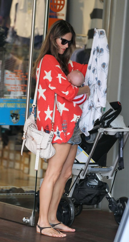 Alessandra Ambrosio looked patriotic yesterday as she visited the Malibu Country Mart with her husband-to-be, Jamie Mazur, and their children, Noah and Anja. Alessandra sported a holiday-appropriate sweater covered in white stars, while Anja's tee was printed with a picture of the American flag. The Victoria's Secret model carried her infant son in her arms as they left the shops.  Alessandra and Jamie shared the first photos of baby Noah Mazur on her Facebook page late last month after welcoming him to the family in May. The new arrival made Anja, who will turn 4 years old next month, a big sister for the first time.
