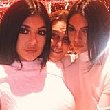 Kylie and Kendall took a photo with their dad, Bruce Jenner.