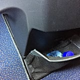 Plus there was another small compartment by your feet, which was convenient since you can't have any bags at your feet for takeoff and landing. The flight attendant helpfully put my purse up in the overhead compartment and brought it back down again for me, so it wasn't really an issue.