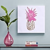 How adorable is this print? We want one in every room Intelligent Design Gold Pineapple Foil Embellished Canvas Art ($25)