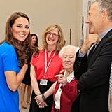 Catherine, Duchess of Cambridge, talked to photographer Nadav Kandar and 100-year-old portrait sitter Diana Gould at the Road To 2012: Aiming High exhibit.