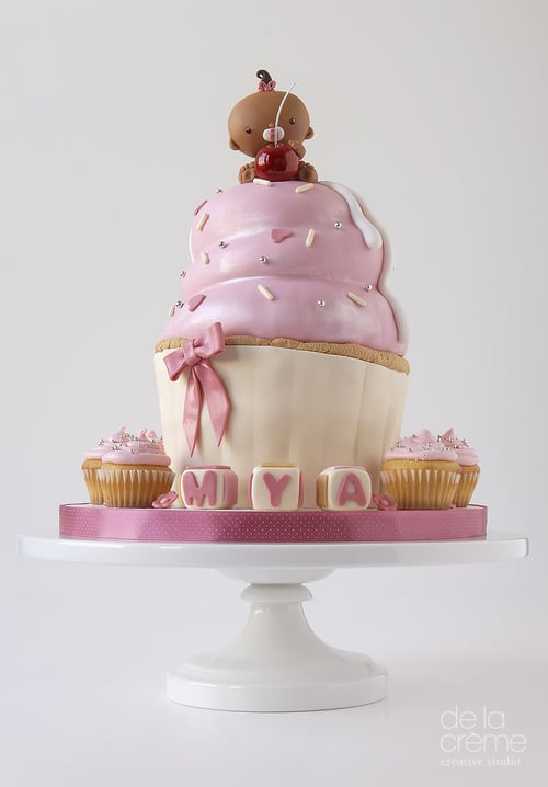 Giant Cupcake With A Baby On Top Pretty Baby Shower Cake Ideas