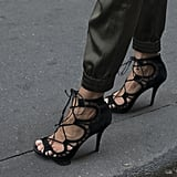 The definition of a sexy black sandal.