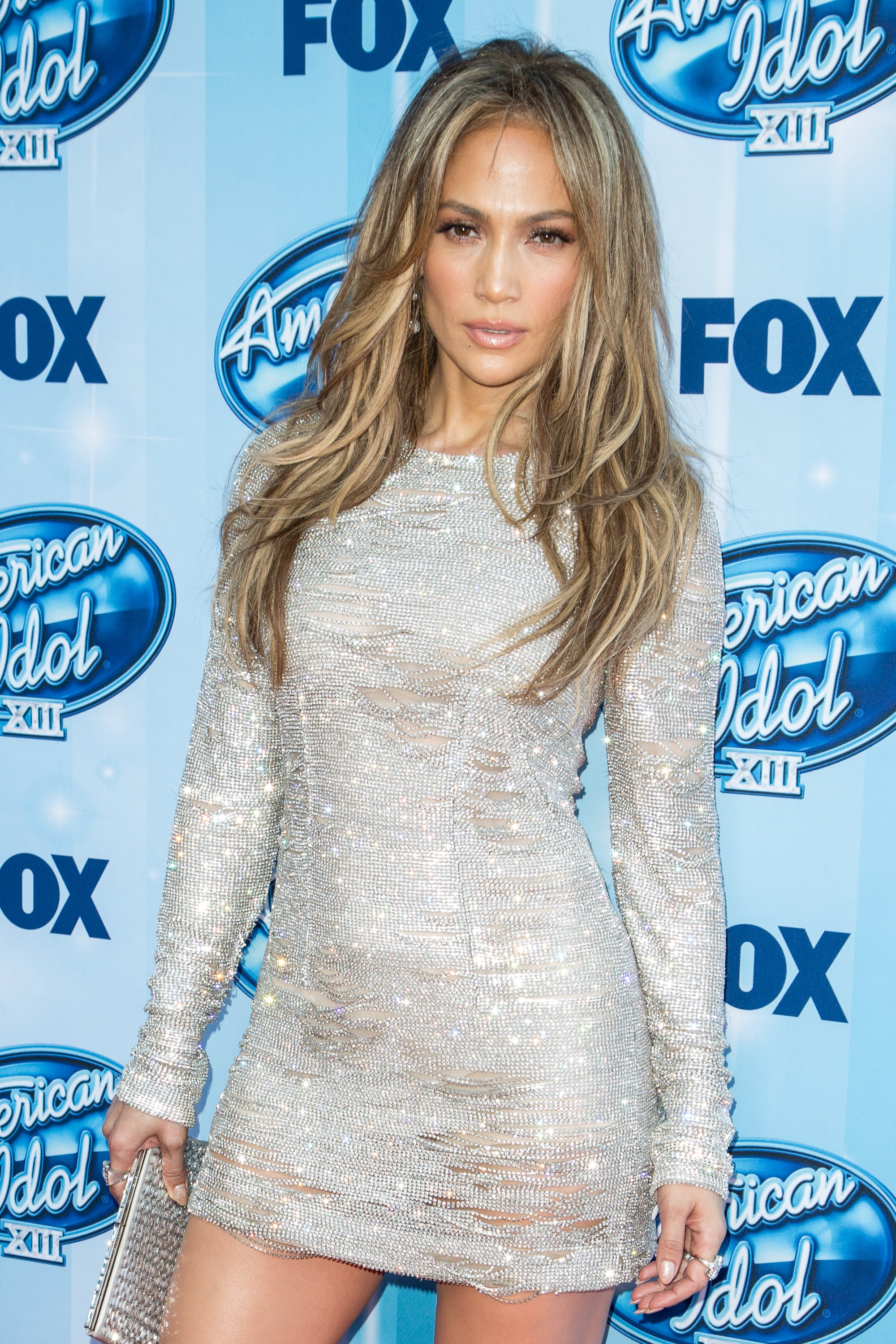 This could very easily be a wax figure. Is she a wax figure?