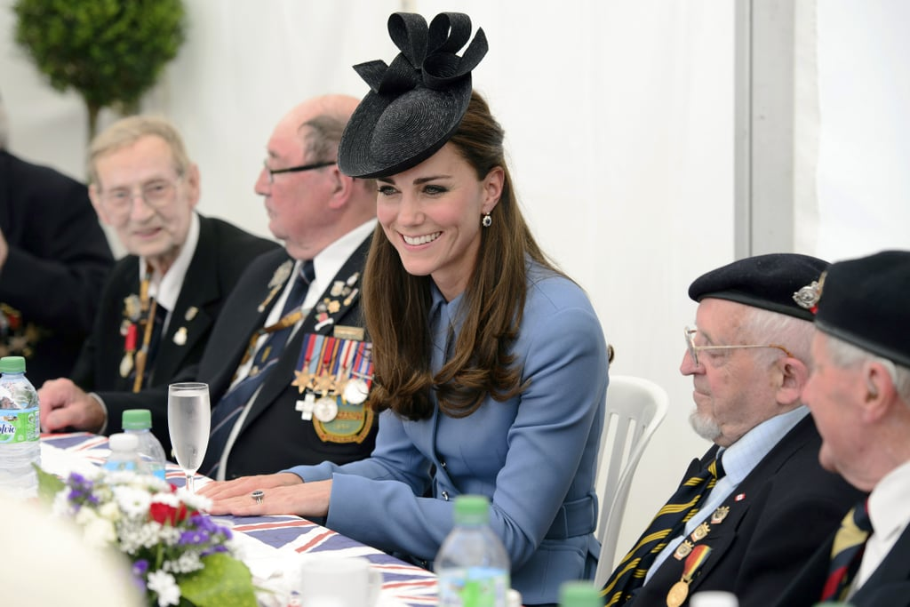 The Duke and Duchess of Cambridge arrived at Gold Beach in Normandy, France, on Friday to join the rest of the British royal family in honoring the 70th anniversary of the D-Day invasion. She wore the same blue Alexander McQueen coat that she sported to a WWI memorial event in New Zealand back in April. She was in France to host a special teatime chat with various veterans. Queen Elizabeth II, Prince Philip, Prince Charles, and Camilla, Duchess of Cornwall, arrived in France on Thursday to kick off memorial events and visit with veterans who fought in France. Earlier in the day, the queen met with President Obama, British Prime Minister David Cameron, Russian President Vladimir Putin, and several other world leaders for a special commemorative event to honor the fallen. The queen's event was perhaps overshadowed by Obama and Putin, who were meeting face to face for the first time since the Ukrainian crisis erupted. Prince Charles, who got in a lot of hot water for comparing Putin to Hitler during an official visit to Canada in May, was not at the queen's event but did cross paths with Putin at the Gold Beach event.  Aside from the important visit to France, Kate Middleton is preparing for her first solo event since returning home from Australia in April. The duchess will attend a breakfast reception at the National Maritime Museum in Greenwich, England, on Tuesday to help raise support for the British Team in the America's Cup. Last week, Will and Kate made a visit to Scotland where they sampled whisky at a distillery, putting an end to the various pregnancy rumors that seem to surround Kate wherever she goes. For more Kate fun, find out what happens when you mix the Duchess of Cambridge with Mean Girls! Source: Getty / LEON NEAL