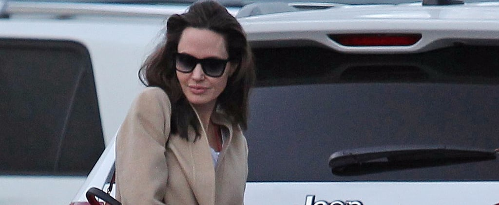 Angelina Jolie Pulled Off the Pajamas-Under-Your-Coat Look We All Want to Wear This Winter