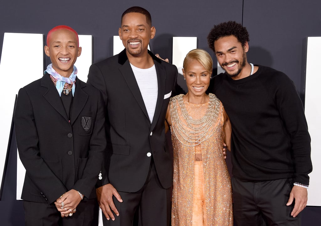 Will Smith was surrounded by loved ones as he attended the premiere of Gemini Man in LA on Sunday. The film sees Will battle a younger version of himself, so it's only fitting that the actor had his own mini-mes there for the premiere. In addition to bringing his wife Jada Pinkett Smith as his date, Will also had the support of his two sons, Trey Smith, 26, and Jaden Smith, 21.  While Trey looked just like his dad with matching facial hair, Jaden copied Will's style as they both wore a black suit. The Smith-Pinkett family, with the exception of Will and Jada's 18-year-old daughter Willow, was all smiles as they huddled together on the red carpet and posed for photos. Keep scrolling to see more of their family outing ahead.       Related:                                                                                                           Is It Just Us, or Is Jaden Smith Slowly Morphing Into His Famous Dad?