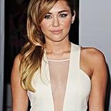 Miley Cyrus worked her Hawaii tan.