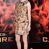 Elizabeth Banks stepped out at the London photocall in a colorful floral, cocktail-length Alexander McQueen sheath styled with a ring by Vita Fede and a pair of metallic cap-toe heels.