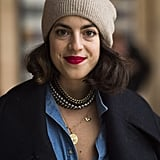 Leandra Medine, aka the Man Repeller, showed off her more classic side with a pop of red on her lips and bouncy waves. Source: Le 21ème   Adam Katz Sinding