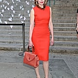 Christine Baranski wore a red dress and held a matching red bag.