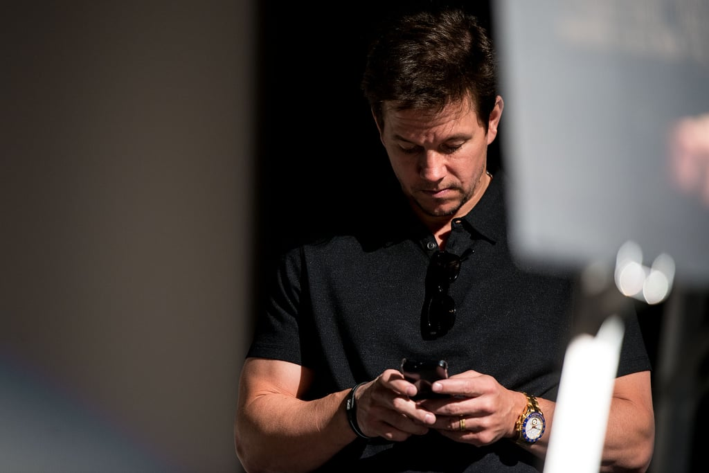 Mark Wahlberg checked his phone at the premiere of Broken City in Philadelphia.