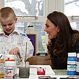 Kate Middleton laughed with a school kid.