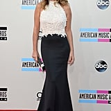 Daisy Fuentes was ready to party in a beaded-bodice gown featuring a black neoprene skirt by Tadashi Shoji.