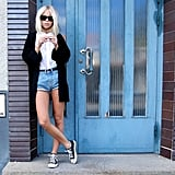 Give your Converse a tough-girl edge with denim cutoffs, retro sunglasses, and darker layers for evening. Photo courtesy of Lookbook.nu