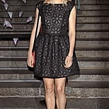 Sienna Miller wore a black Topshop dress.
