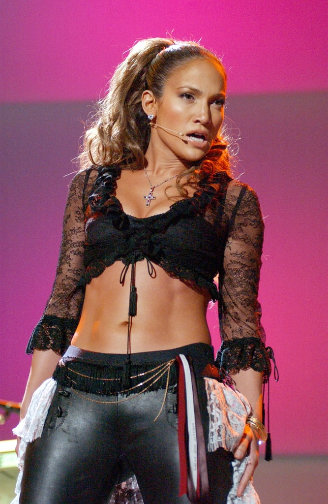 """If you're wondering why Jennifer Lopez frequently hits the red carpet in naked dresses, all you have to do is look at her abs. With a core like hers, wouldn't you want to show it off every chance you could?  Though J Lo has evolved since her """"Jenny From the Block"""" days, the 46-year-old singer and Shades of Blue actress, who gave birth to twins Max and Emme in 2008, still gives her supertoned midsection a chance to shine. Ahead, we've rounded up some of her most ab-tastic pictures over the years. Keep scrolling to admire them all. Then, if you're feeling inspired to work out your core, try this fun workout.      Related:                                                                                                           6 of Jennifer Lopez's Hottest and Most Badass Workout Moments"""