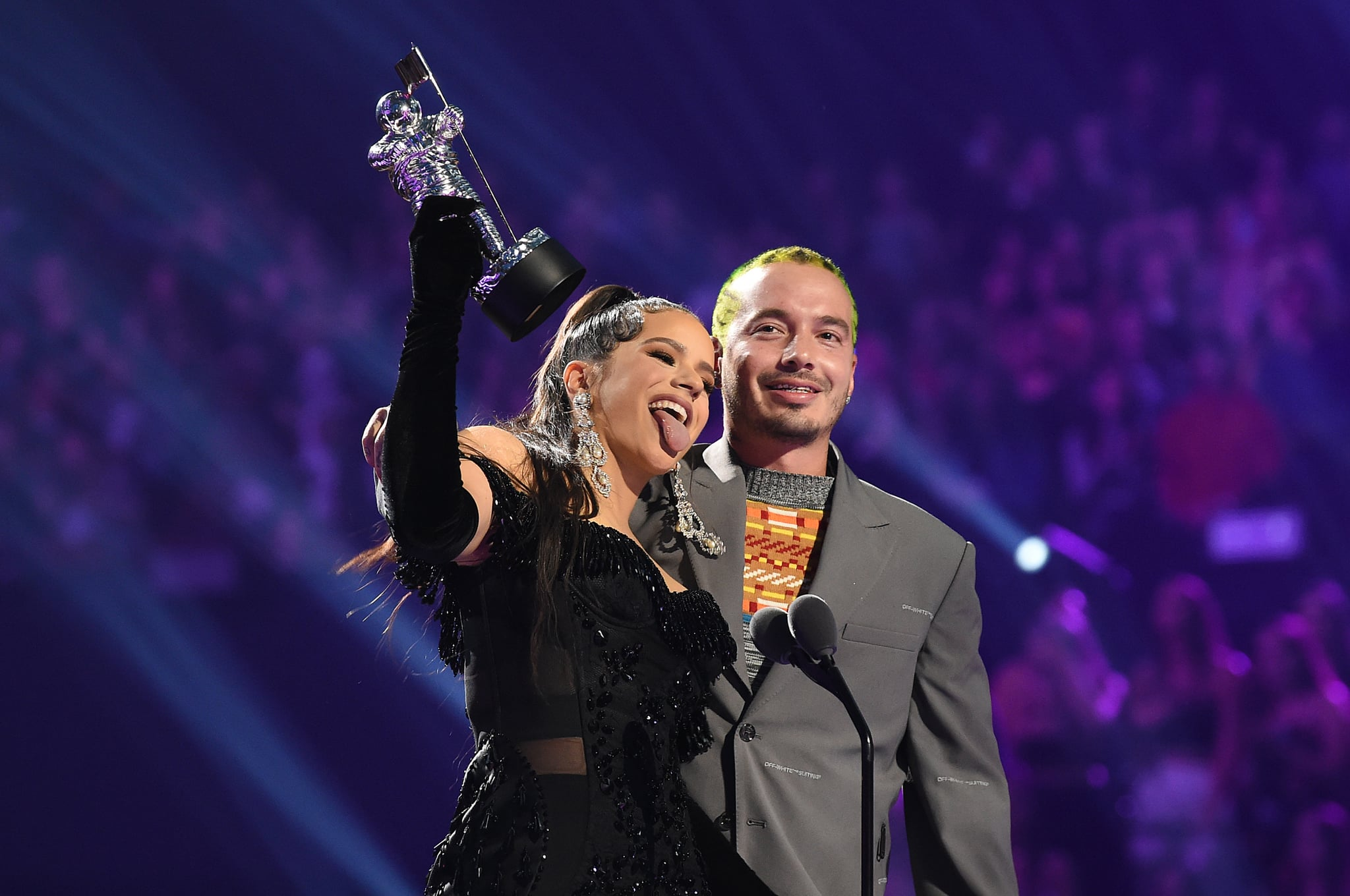 NEWARK, NEW JERSEY - AUGUST 26: ROSALÍA and J Balvin speak onstage during the 2019 MTV Video Music Awards at Prudential Centre on August 26, 2019 in Newark, New Jersey. (Photo by Dimitrios Kambouris/VMN19/Getty Images for MTV)