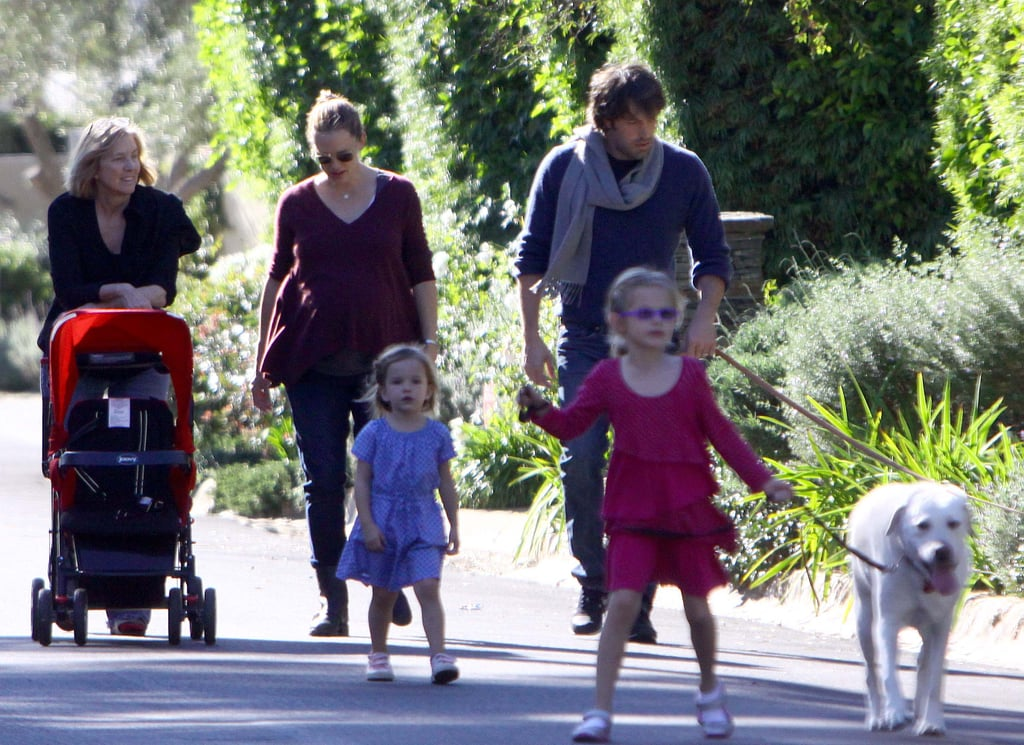 The Garner-Affleck clan took their Labrador, Martha Stewart, out for an LA walk as a family on New Year's Day in 2012.