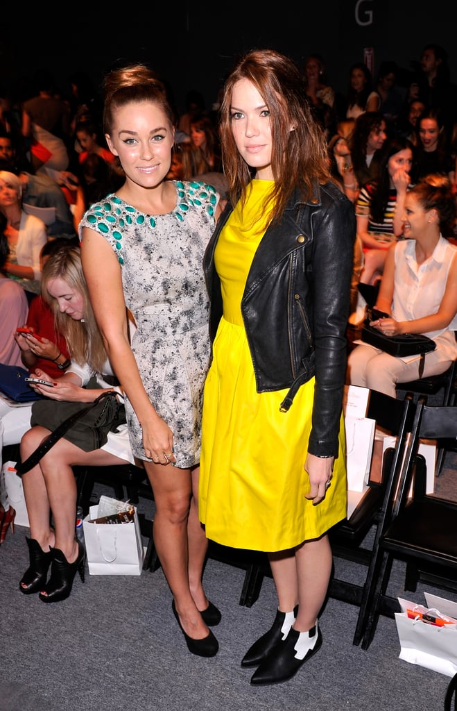 Lauren Conrad, in a printed sheath, and Mandy Moore, in a bright yellow number, posed together while waiting for the Lela Rose show to begin.