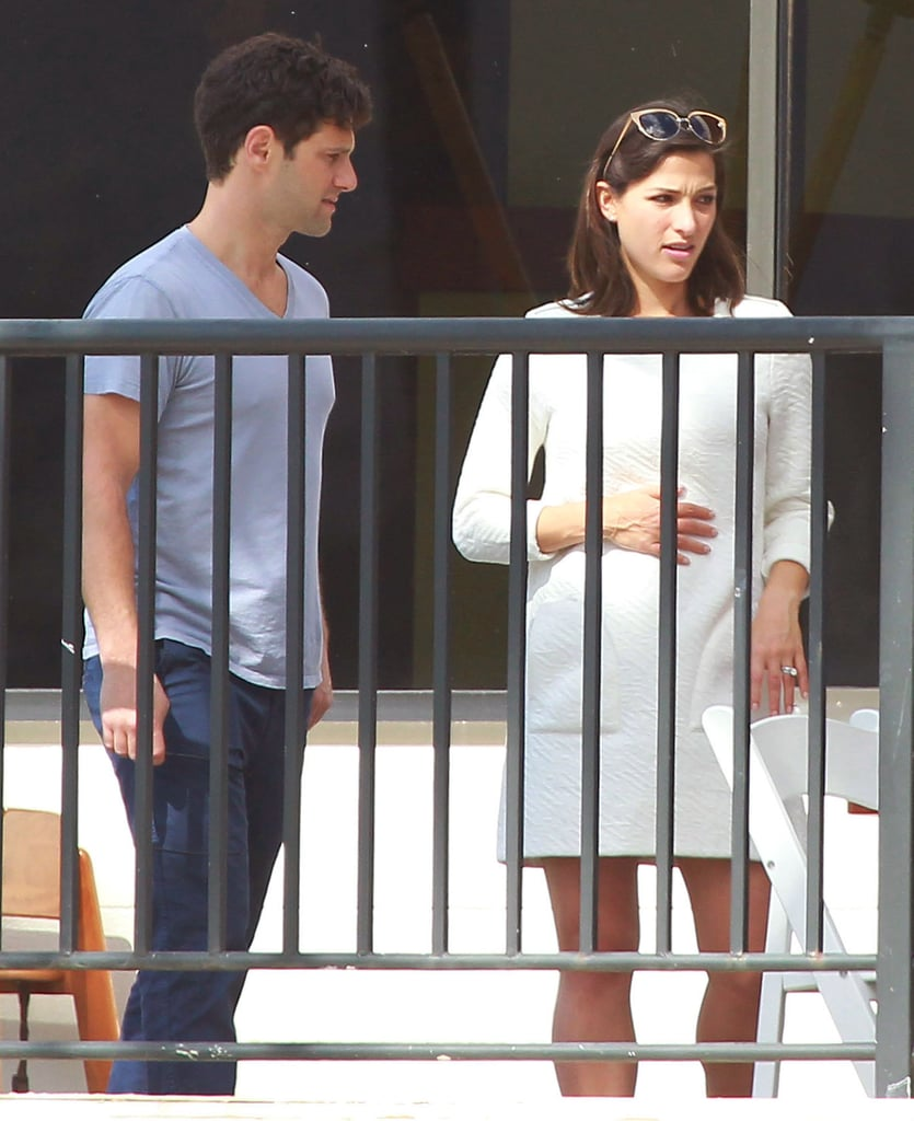 "Justin Bartha and his new bride, Lia Smith, met up with friends, including Jesse Eisenberg and Ken Jeong, for brunch in Hawaii on Sunday. The casual affair came after the couple's wedding at the Turtle Bay resort on Saturday. Reese Witherspoon and Jim Toth traveled to the destination wedding on the island of Oahu to hear the Hangover star and Lia say, ""I do."" Reese was joined by her husband, Jim, who is Justin's agent. The group gathered outside for the ceremony, sitting under the warm Hawaiian sun as they awaited Justin and Lia's first kiss as husband and wife. Lia graced the aisle in a white dress with thin straps, minimal makeup, and an effortless updo, while Justin donned a black suit and white pocket square. Justin and Lia have more than just their new relationship status to celebrate — they are reportedly expecting their first child! Hawaii holds a special meaning for the bride and groom: they were first photographed together on a beach in Maui during a New Year's vacation in January 2013. Lia and Justin reportedly took the trip after they met at an Equinox gym in LA, where she taught Pilates. Lia said yes to Justin's proposal that May. Keep reading to see their romantic wedding pictures!"