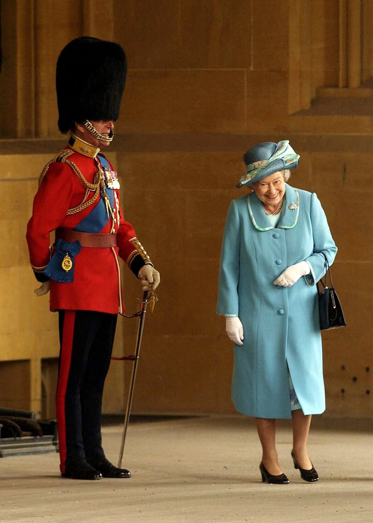 Queen Elizabeth appears even shorter when Prince Philip wears his uniform and bearskin hat.