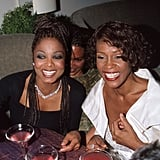 Janet Jackson and Whitney Houston enjoy Elton John's AIDS Foundation Party on Oscar night in 1999.