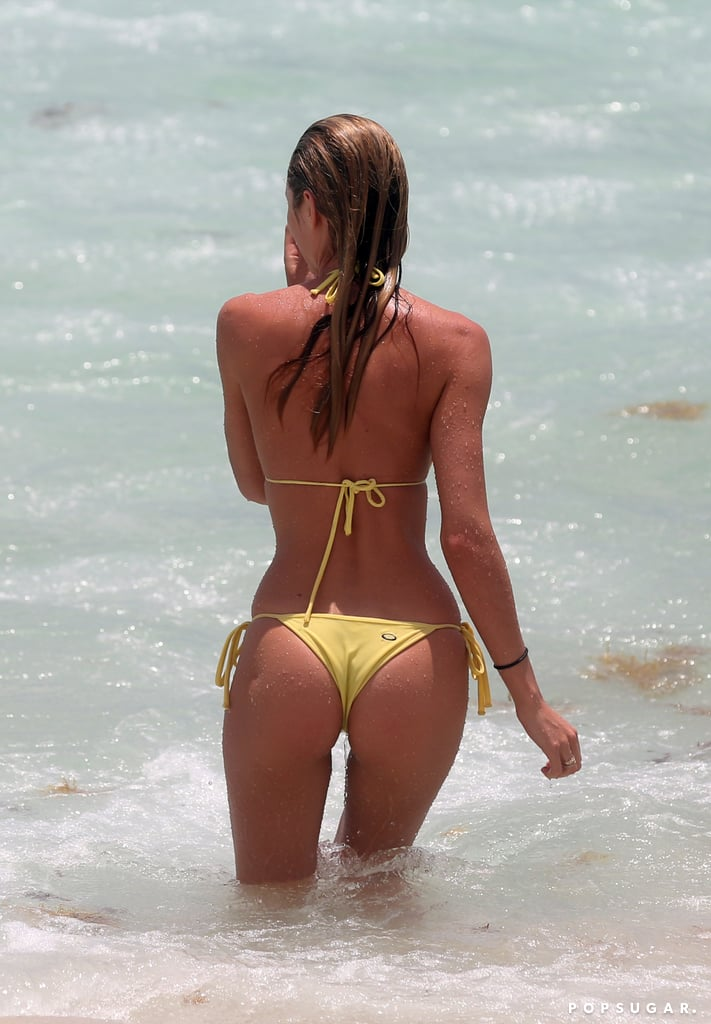 Candice Swanepoel Turns Heads in a Tiny Yellow Bikini