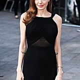 As for the details, Angelina didn't opt for any bells and whistles, just a couple of gold bracelets and delicate gold studs.