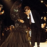 A bride in a luxurious black wedding gown at his 1985 haute couture presentation.