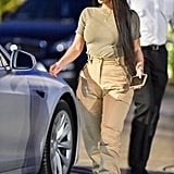 Kim Kardashian knows her way around a pair of high-waisted pants, making them look effortless with a simple T-shirt and ankle boots.