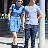 Anne Hathaway had a big smile on her face as she held Adam Shulman's hand.